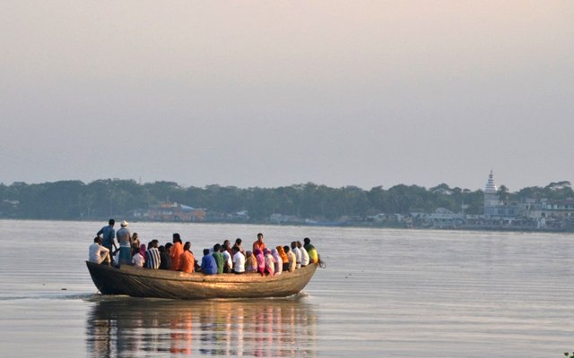 People crossing one of the many rivers in coastal Bangladesh Ganges-Brahmaputra Delta region