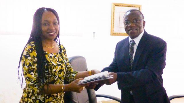 Dr Elias T. Ayuk, Director, UNU-INRA (right) presenting policy briefs to Maria Emilia Almeida, Deputy Head of Mission, Angola Embassy, Accra