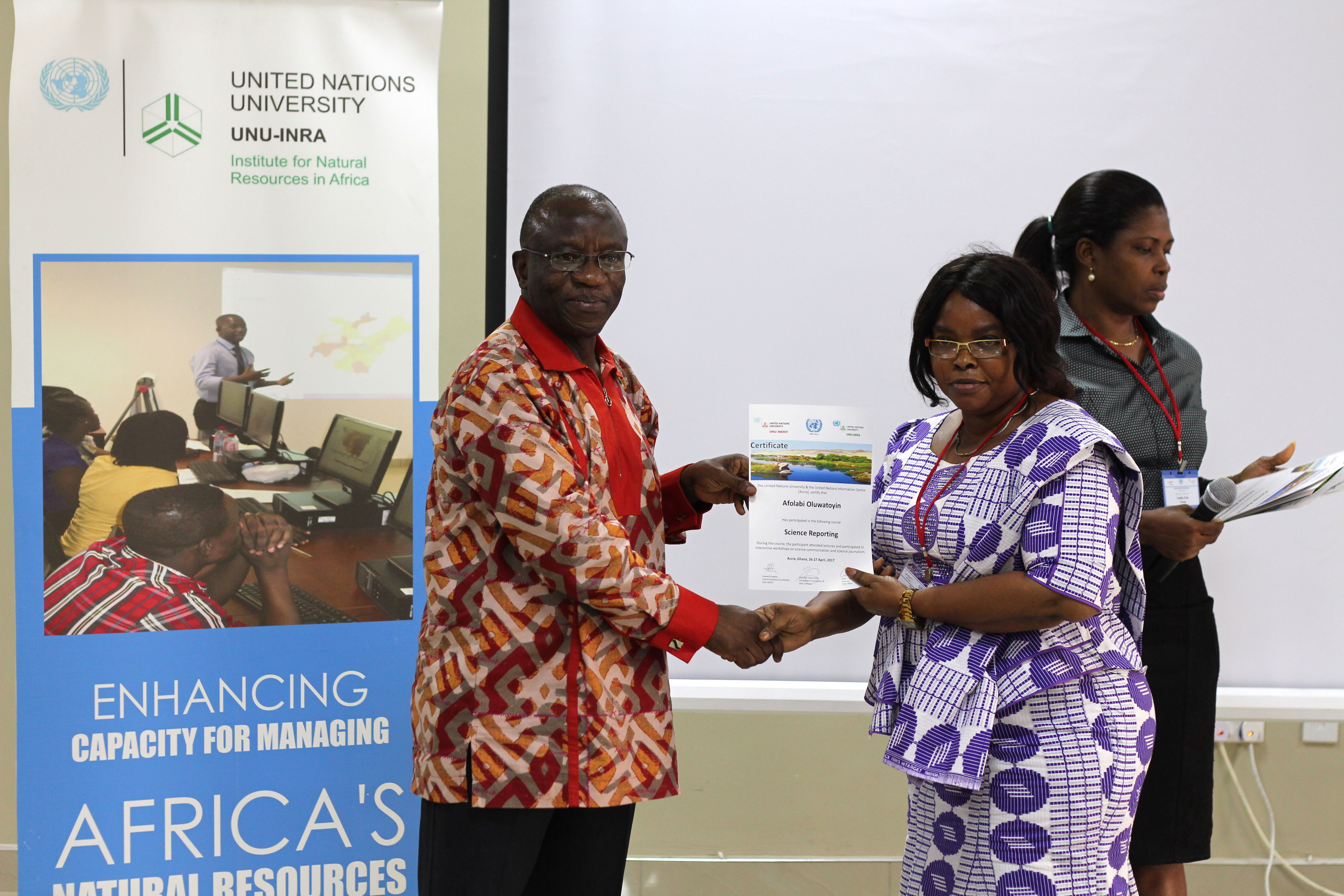 Dr Elias T. Ayuk, Director, UNU-INRA presenting a certificate to a participant