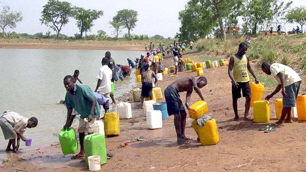 Rural dwellers fetching water from a local lake in Northern Ghana by Izumi Kikkawa-2