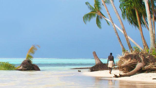carteret-islander-walks-amongst-king-tide-foreshore-erosion