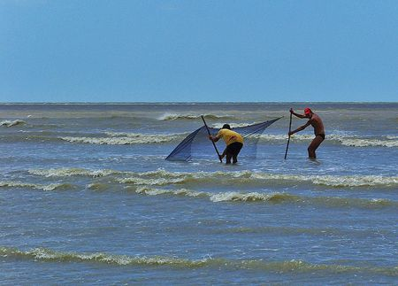 Fishermen set a net in Jericoacoara, Brazil.