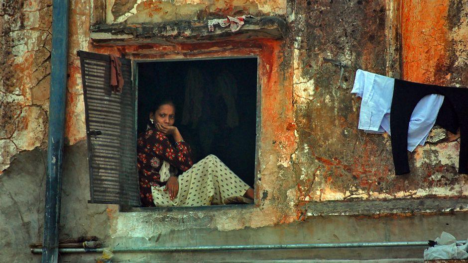 Pensive woman in window