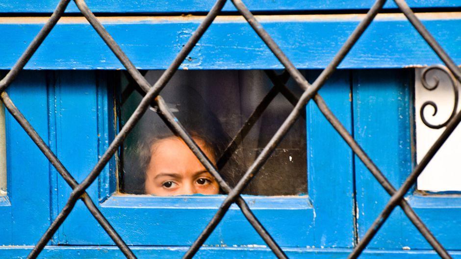 girl in blue window
