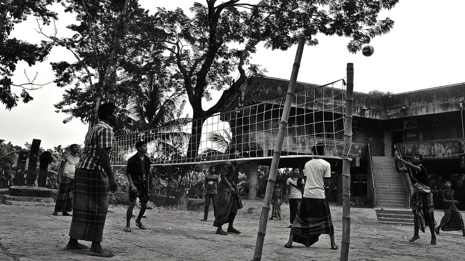 A group of young men playing volleyball in front of the cyclone shelter as the sun goes down in Gabtola, one of the coastal study sites in Bangladesh. Photo: © 2014 Sonja Ayeb-Karlsson. All rights reserved.