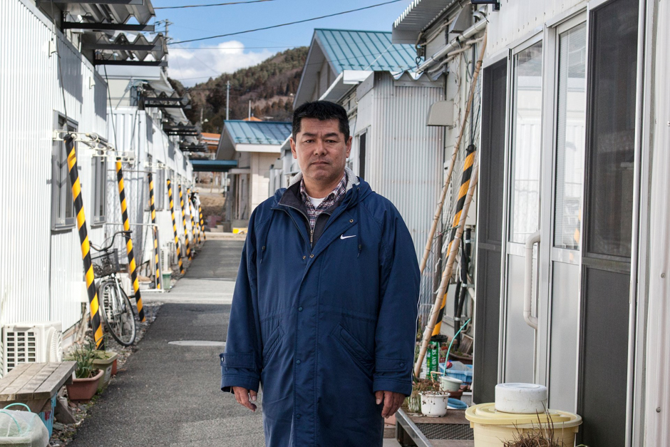 Kazuo Sato, a fisherman before the tsunami, became president of a residents' association and volunteer fireman. Photograph © Kazuma Obara/The Guardian