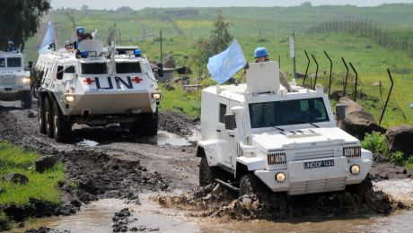 UN peacekeepers of the United Nations Disengagement Observer Force (UNDOF) patrol the Golan Heights area between Camp Faouar and Camp Ziouani, Syria