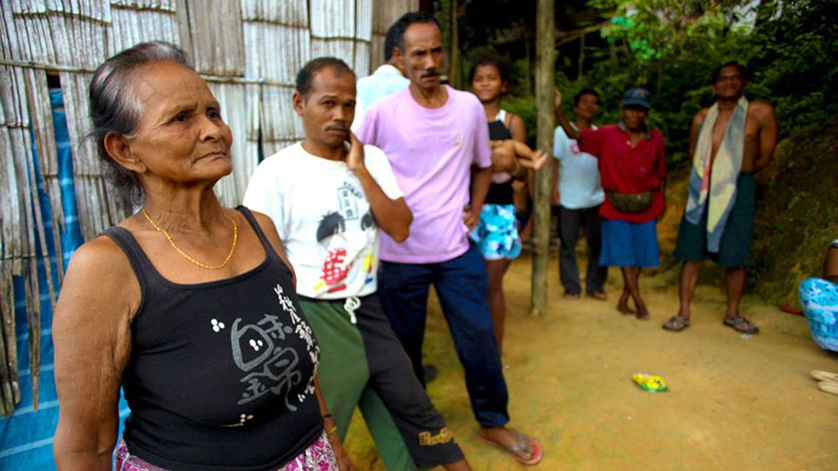 Orang Asli elders gather outside the house of the village chief's brother. This village, like many others, is experienced in dealing with land right issues, and therefore actively involved in standing together as a community