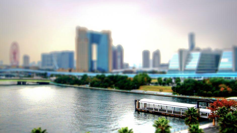 Greening the world economy through cities