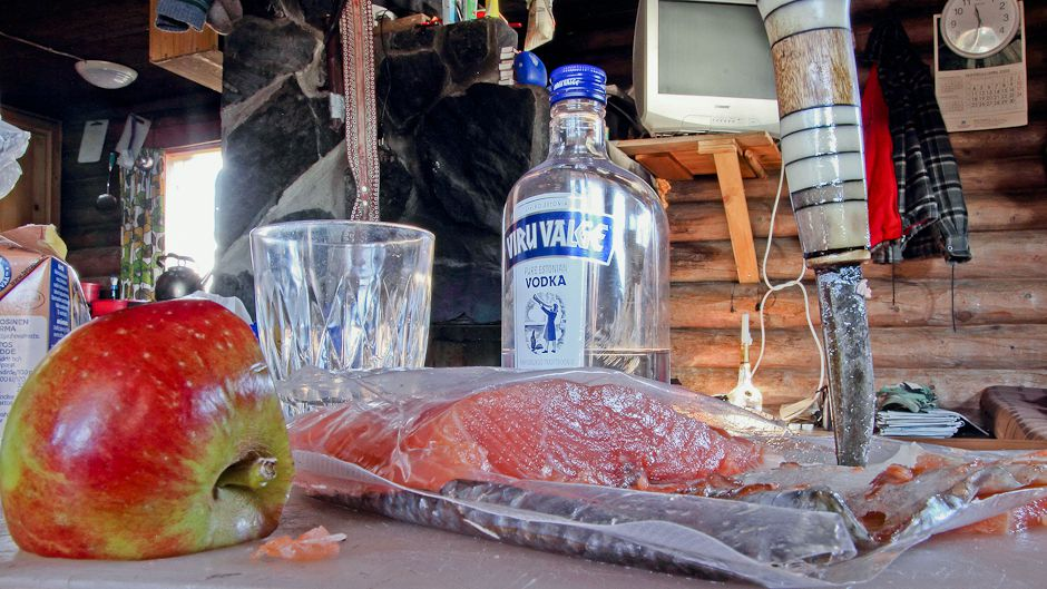 Like generations of Skolts before him, Jouko Moshnikoff welcomes guests at his fishing camp with salted and cold-smoked Atlantic salmon caught nearby. Photo: © Gleb Raygorodetsky 2012.