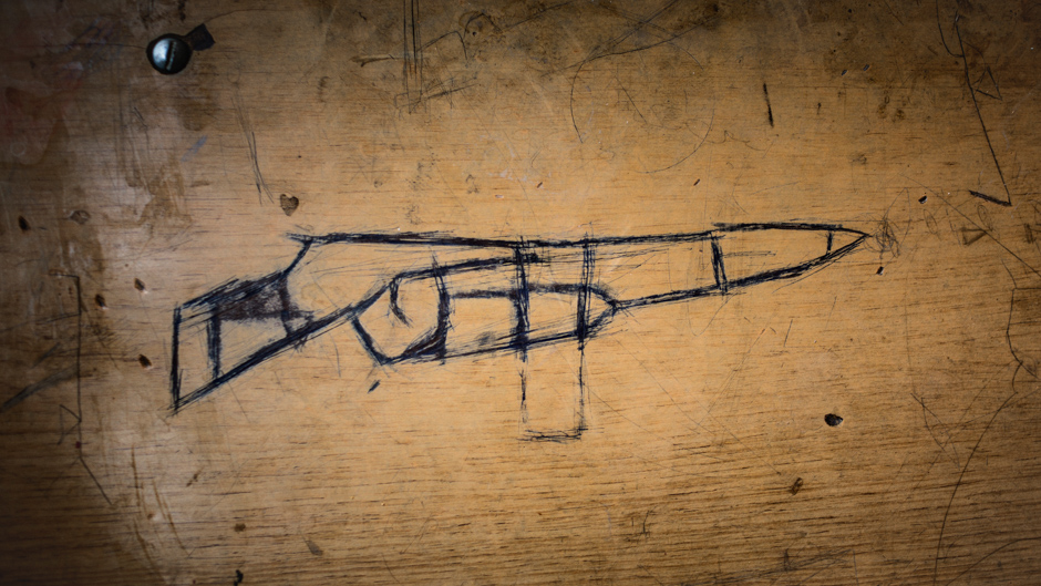 A gun drawn on a school desk in Northern Iraq, 2016. From: Hijacked Education, Diego Ibarra Sánchez