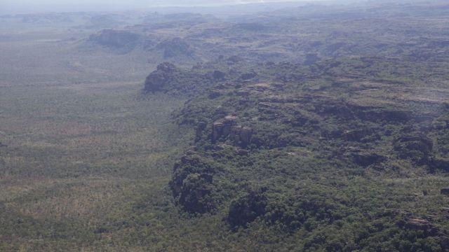 Early dry season savanna burns in distance. West Arnhem Land Indigenous and adjoining pastoral lands. Photo: UNU