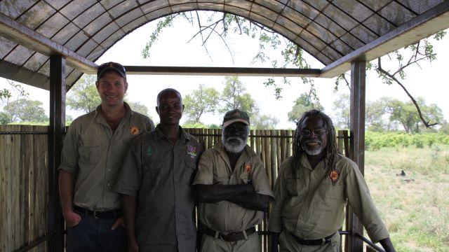 Namibian rangers discuss fire management with indigenous Australian fire ecologists in Nambia. L to R: Shaun Ansell, Wardekken Land Management Australia; Singwanga Matambo, a Namibian Parks Ranger; Nigel Gellar, Wardekken; Dean Yibarbuk, Wardekken. Photo: UNU