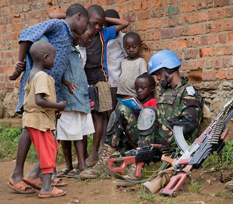 Peacekeeper reading to kids