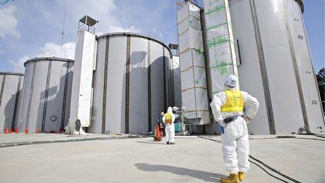 A worker at the Fukushima Daiichi plant looks at tanks, under construction, to store radioactive water. Photo: © Toru Hanai/AP